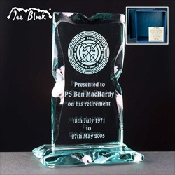 A UK made glass award, engraved to commemorate the retirement of a Police Officer.