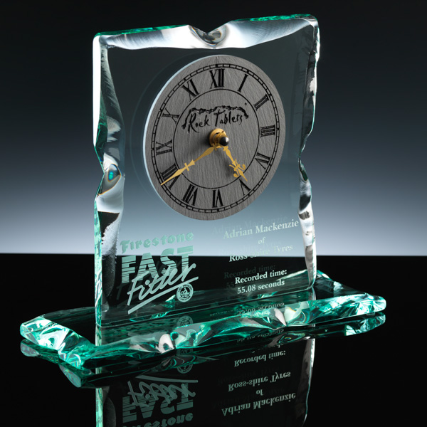 Engraved glass clock for desk or mantel.